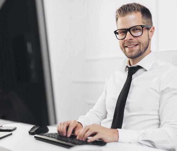 successful-businessman-working-in-his-office-5MJ8DSK.jpg